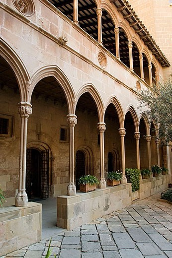 Old Gothic cloister (15th century) of Montserrat benedictine monastery. Barcelona province, Spain : Stock Photo