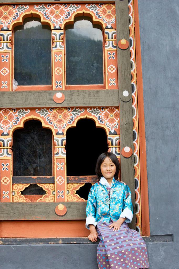 Stock Photo: 1566-352182 Bhutan. Thimpu. Thimpu Dzong Monastery. Buddhist Festival (Tsechu). Bhutanese little girl.