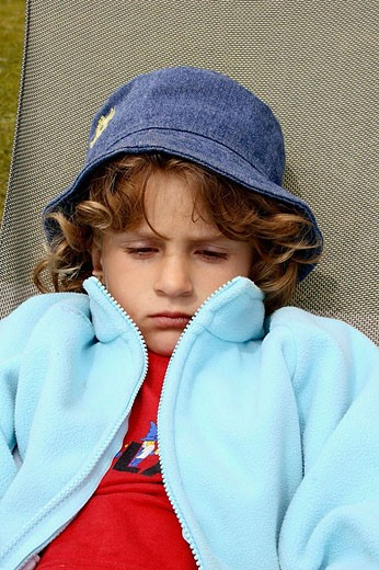 Stock Photo: 1566-353667 Five year old girl resting.