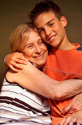 Stock Photo: 1566-354580 Grandmother being hugged by her grandson.