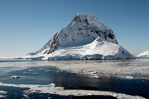 Lemaire Channel with Petermann Island in the background. Antartic Peninsula : Stock Photo