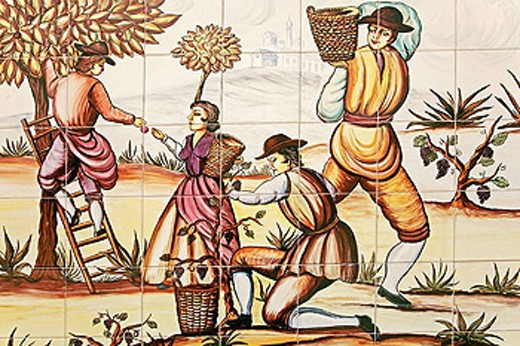 Painting on ceramic tiles representing figues and wine grapes harvest. Málaga province. Andalucia. Spain. : Stock Photo