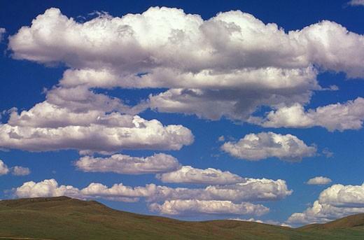 Clouds over the open grasslands of Mongolia. Gobi Gurvansaikhan National Park : Stock Photo