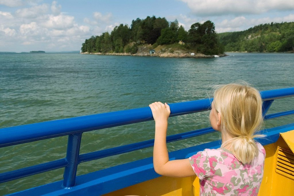 Stock Photo: 1566-357072 Girl watching the islands from a small car ferry. Sweden.