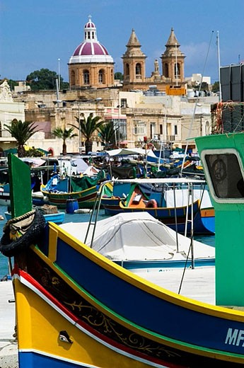 Stock Photo: 1566-359099 Local fishing boats or Luzzu, decorated with Osiris eyes for good luck. Marsaxlokk. Malta.