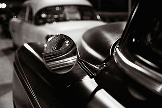 Rearview mirror of a classic car from the 40s or 50s. : Stock Photo