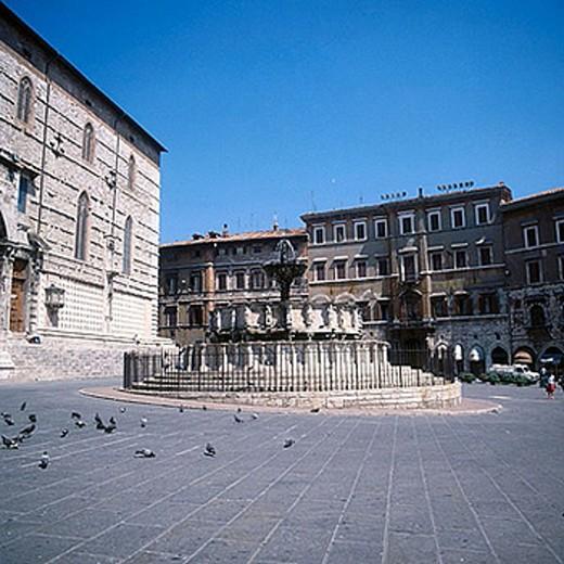 Piazza Quattro Novembre. Fontana Maggiore, (Sculptors: Nicola and Giovanni Pisano, 1278). Perugia. Italy : Stock Photo