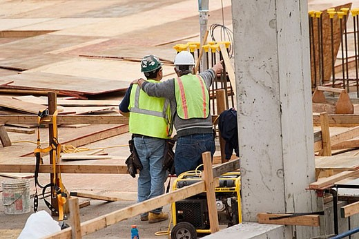 Workers at a construction site. : Stock Photo