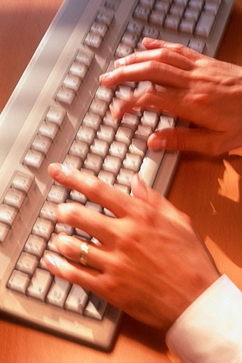 Man´s hands on computer keyboard : Stock Photo