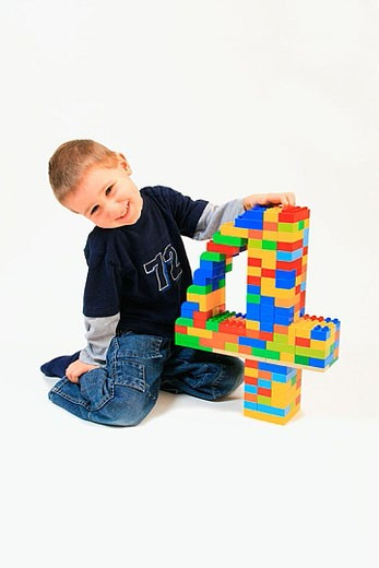 boy playing with toy, Lego, on his fourth birthday,  Studio, Oetwil am See, Zuerich, Switzerland, : Stock Photo