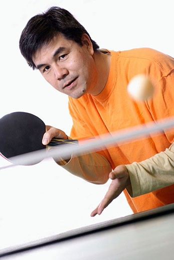 Asian man playing ping pong : Stock Photo