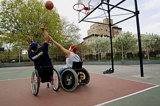 Men in wheelchairs playing basketball : Stock Photo