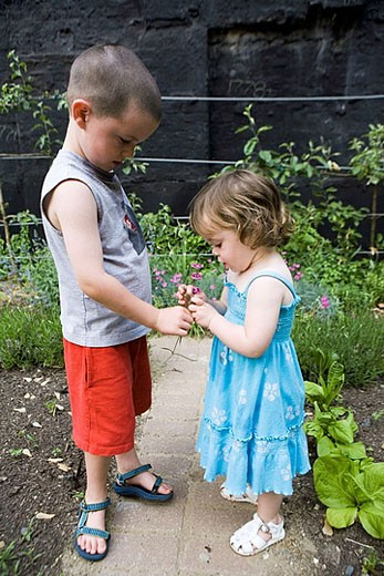 Brother and sister in garden. : Stock Photo