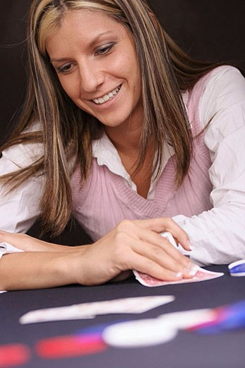 Stock Photo: 1566-386192 Woman smiling in a card game