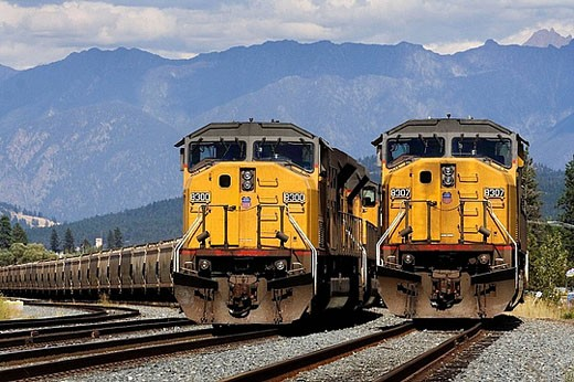 Stock Photo: 1566-388873 Two Union Pacific trains in British Columbia, Canada, in Canadian Pacific territory.