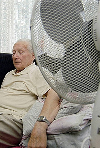 The summer heat is a health hazard for Senior citizens. : Stock Photo