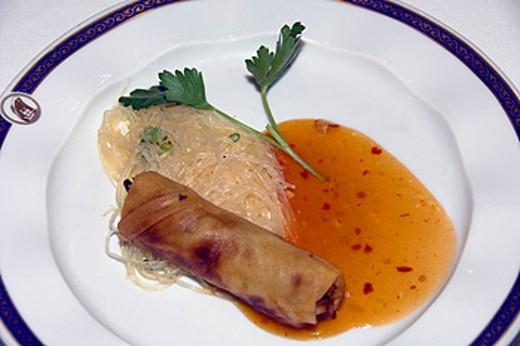 Thai Crispy Rolls appetizer with seasoned rice and sweet chili sauce on the Holland America cruise ship Ryndam. : Stock Photo