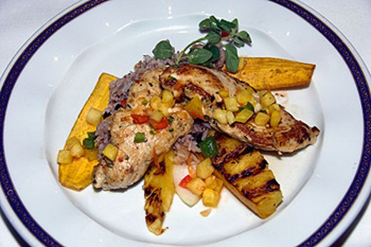 Stock Photo: 1566-396318 Chili Spiced Chicken Breast with pineapple spears dinner on the Holland America cruise ship Ryndam.