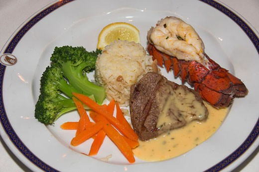 Stock Photo: 1566-396327 Surf and Turf dinner of steak and lobster on the Holland America cruise ship Ryndam.