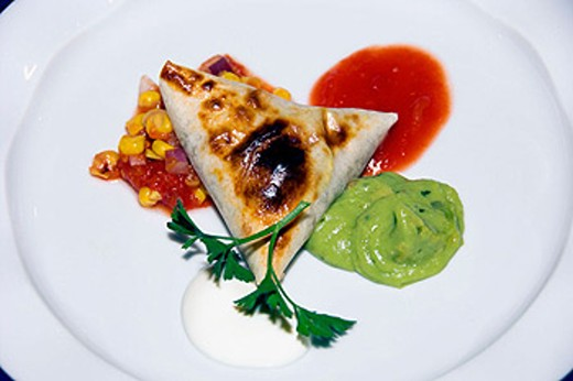 Duck and Black Bean Quesadilla appetizer on the Holland America cruise ship Ryndam. : Stock Photo