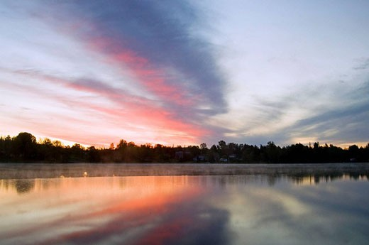 Dawn skies reflected in Simon Lake. Ontario, Canada : Stock Photo
