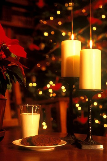 Milk and cookies with candles, Christmas Eve interior : Stock Photo
