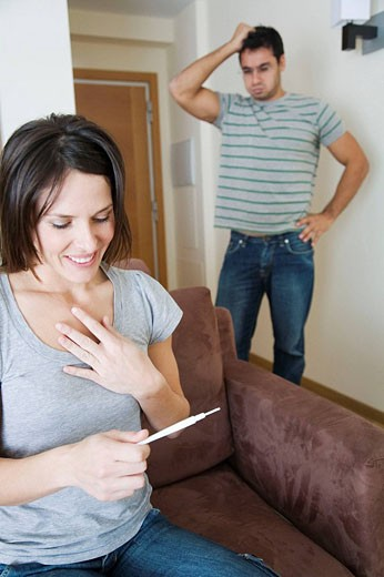 Stock Photo: 1566-402549 Different reactions in a couple after a pregnancy test.
