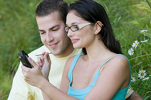 Sharing a handheld wireless device : Stock Photo
