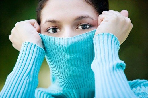 Playing with her turtleneck : Stock Photo
