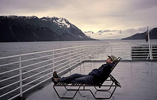 Man on deck of boat, Alaska : Stock Photo