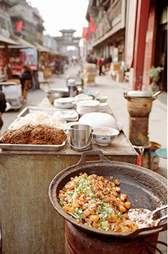 Various food stalls can be found in the old city of Xian. : Stock Photo