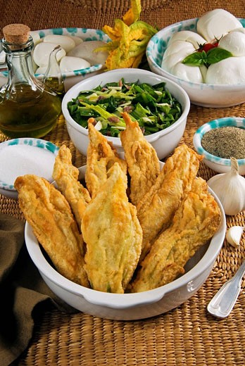 Stock Photo: 1566-408337 Roman food,  ´Fiori di zucca fritti e puntarelle´, fried pumpkin flowers filled with mozzarella cheese, and puntarelle salade