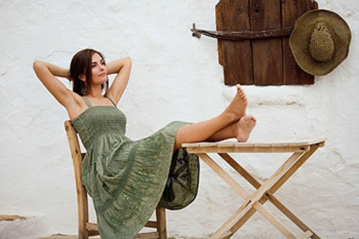 Stock Photo: 1566-410156 Young woman resting in a rural atmosphere
