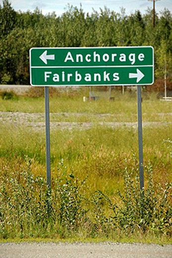 Sign marker designates directions along Parks Highway Alaska AK U S United States Anchorage Fairbanks : Stock Photo