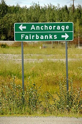 Stock Photo: 1566-411071 Sign marker designates directions along Parks Highway Alaska AK U S United States Anchorage Fairbanks
