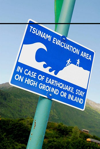 Tsunami Evacuation Route sign marker Valdez Prince William Sound Alaska AK United States U S Earthquake safety plan danger caution preparation : Stock Photo