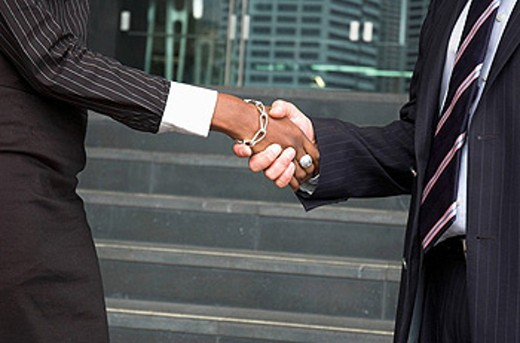 Male and female businesspeople shaking hands : Stock Photo