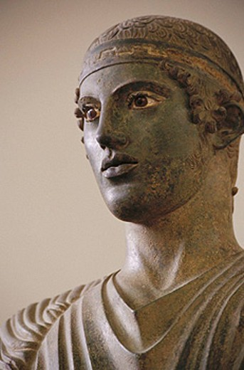 The Charioteer, bronze statue erected in 474 BC to commemorate the victory of a chariot team in the Pythian Games (which were held at Delphi) now in the Delphi Archaeological Museum, Greece : Stock Photo