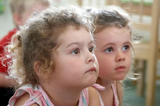 Stock Photo: 1566-420372 selective focus, Headshot, 2 little girls together
