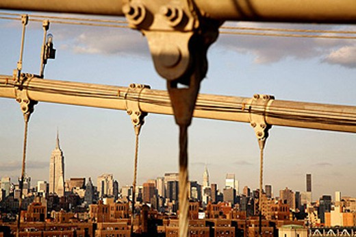 The skyline of New York City from Brooklyn Bridge. New York City. USA : Stock Photo