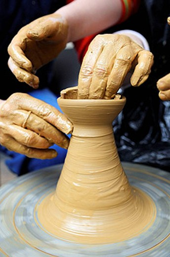 Stock Photo: 1566-426154 Traditional potter at work