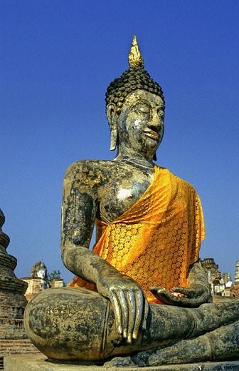Thailand, Sukhothai, statue of sitting Buddha with sash : Stock Photo