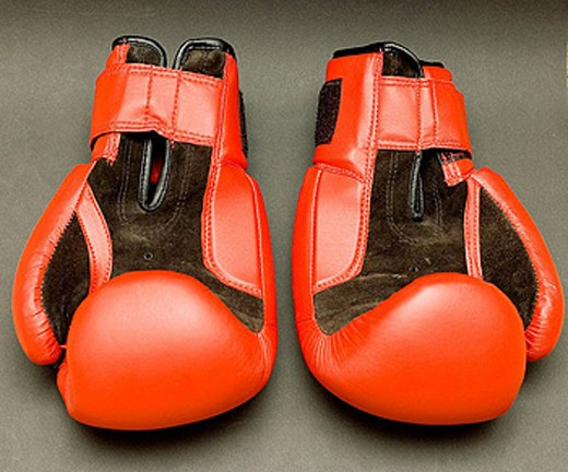 Pair of red boxing gloves : Stock Photo