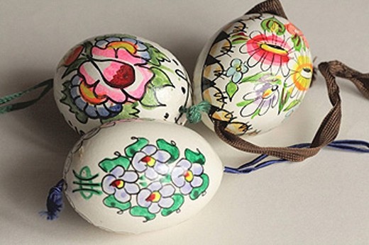 Three traditional handpainted Czech Easter eggs with ribbons : Stock Photo