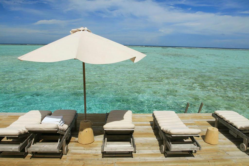 Stock Photo: 1566-430696 White Umbrella on Beachside, Maldives