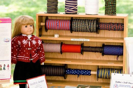 Ribbons for making Handmade Swedish doll dresses  Svenskarnas Dag Swedish Heritage Day Minnehaha Park Minneapolis Minnesota USA : Stock Photo