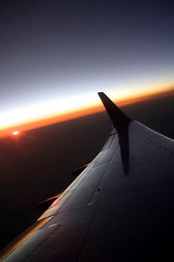 Stock Photo: 1566-433498 BOEING 737 700 WING, SUNSET GLOW,