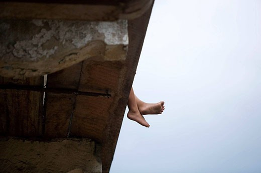 Stock Photo: 1566-434291 CHILDS FEET HANGING OVER BALCONY CASCO ANTIGUO SAN FILIPE PANAMA CITY REPUBLIC OF PANAMA