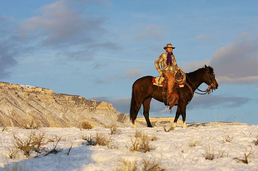 Stock Photo: 1566-440488 Cowboy out for a winter ride, Shell, Wyoming. Usa