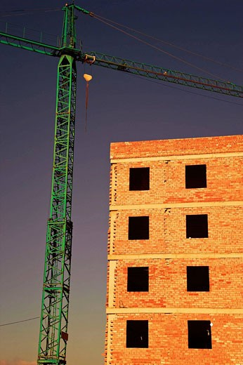 Stock Photo: 1566-441024 Crane beside building under construction